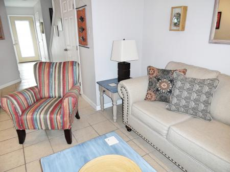 Click to enlarge image Sofa is a queen sleeper - BeeGee's Redfish Quarters - Large 2 bedroom, 2.5 bath with tile and laminate floors, private laundry, Dog Friendly. Walk to the beach. Covered Patio.