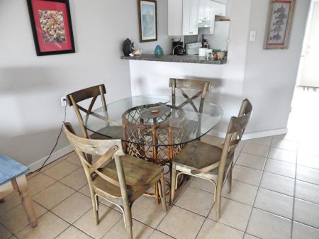 Click to enlarge image Dining area - BeeGee's Redfish Quarters - Large 2 bedroom, 2.5 bath with tile and laminate floors, private laundry, Dog Friendly. Walk to the beach. Covered Patio.