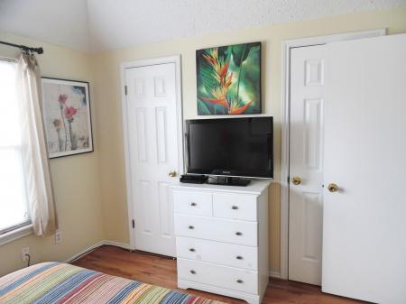 Click to enlarge image Two large closets in each bedroom - BeeGee's Redfish Quarters - Large 2 bedroom, 2.5 bath with tile and laminate floors, private laundry, Dog Friendly. Walk to the beach. Covered Patio.