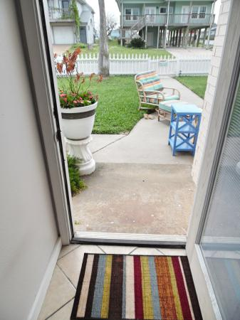 Click to enlarge image Front entrance to dog friendly fenced yard - BeeGee's Redfish Quarters - Large 2 bedroom, 2.5 bath with tile and laminate floors, private laundry, Dog Friendly. Walk to the beach. Covered Patio.