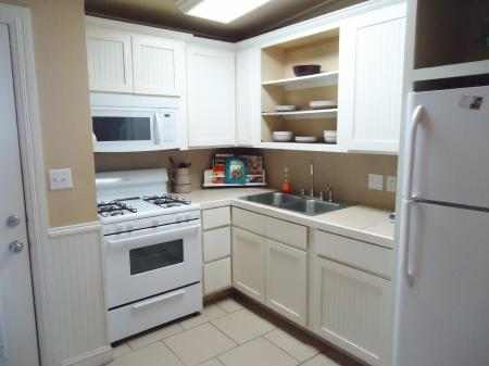 Click to enlarge image Fantastic kitchen! - The Little Blue House - Cutest efficiency in Port Aransas. Full kitchen, comfy bed plus pull out sofa, beautiful decor in Old Town. Walk to beach, dog friendly with small fenced area and outdoor seating.