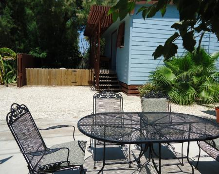 Click to enlarge image Good outside space to relax! - The Little Blue House - Cutest efficiency in Port Aransas. Full kitchen, comfy bed plus pull out sofa, beautiful decor in Old Town. Walk to beach, dog friendly with small fenced area and outdoor seating.