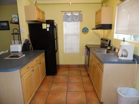 Click to enlarge image Bright cheery kitchen - Palm Cottage - Old town cottage near historic downtown Port Aransas. Two bedrooms, one bath, small laundry, quaint and cute patio area. Dog Friendly