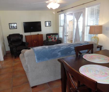 Click to enlarge image Open kitchen, dining, living room - Palm Cottage - Old town cottage near historic downtown Port Aransas. Two bedrooms, one bath, small laundry, quaint and cute patio area. Dog Friendly