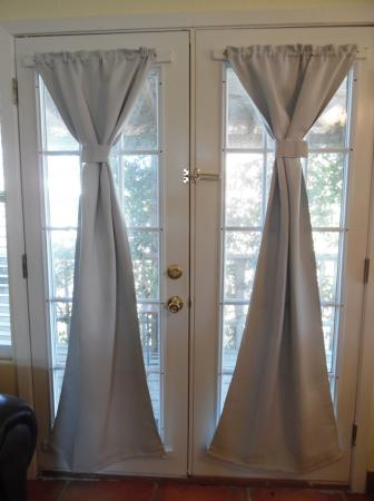Click to enlarge image Patio doors to lovely small shaded deck - Palm Cottage - Old town cottage near historic downtown Port Aransas. Two bedrooms, one bath, small laundry, quaint and cute patio area. Dog Friendly