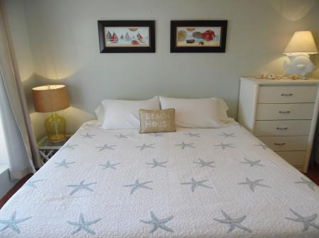 Click to enlarge image Master bedroom with king bed - Palm Cottage - Old town cottage near historic downtown Port Aransas. Two bedrooms, one bath, small laundry, quaint and cute patio area. Dog Friendly
