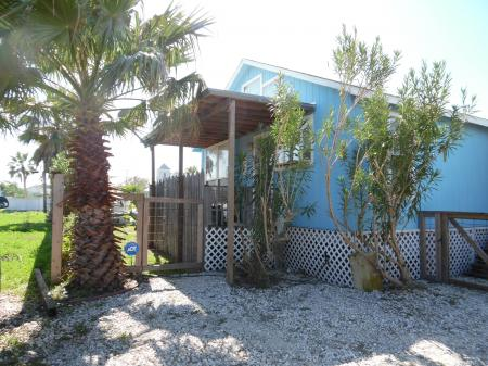 Click to enlarge image Palm Cottage is back and better than ever! - Palm Cottage - Old town cottage near historic downtown Port Aransas. Two bedrooms, one bath, small laundry, quaint and cute patio area. Dog Friendly