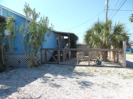 Click to enlarge image Plenty of parking off street and boat parking in the huge back yard! - Palm Cottage - Old town cottage near historic downtown Port Aransas. Two bedrooms, one bath, small laundry, quaint and cute patio area. Dog Friendly