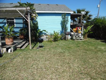 Click to enlarge image Huge back yard off kitchen - Palm Cottage - Old town cottage near historic downtown Port Aransas. Two bedrooms, one bath, small laundry, quaint and cute patio area. Dog Friendly