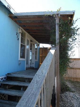 Click to enlarge image Entry to the cottage living room - Palm Cottage - Old town cottage near historic downtown Port Aransas. Two bedrooms, one bath, small laundry, quaint and cute patio area. Dog Friendly
