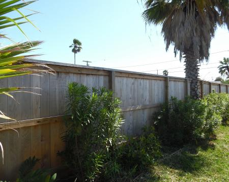 Click to enlarge image Large fully fenced yard for kids and dogs - Palm Cottage - Old town cottage near historic downtown Port Aransas. Two bedrooms, one bath, small laundry, quaint and cute patio area. Dog Friendly