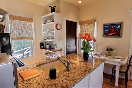 Click to enlarge image Native Texas pink granite adorns the counters. - SEA OATS COTTAGE - Gracious getaway for two!!