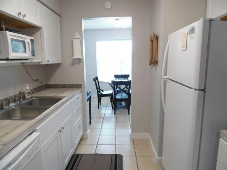 Click to enlarge image From kitchen to the dining area - BeeGee's Tarpon Quarters - One bedroom, with king bed, one bath. LARGE condo with laundry, tile floors, Dog Friendly.Walk to the beach.