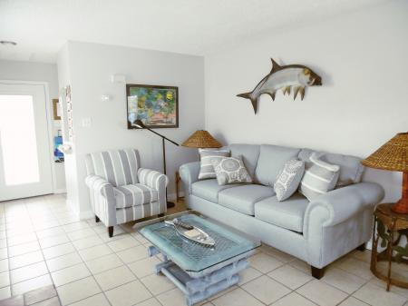 Click to enlarge image Newly remodeled living room - BeeGee's Tarpon Quarters - One bedroom, with king bed, one bath. LARGE condo with laundry, tile floors, Dog Friendly.Walk to the beach.