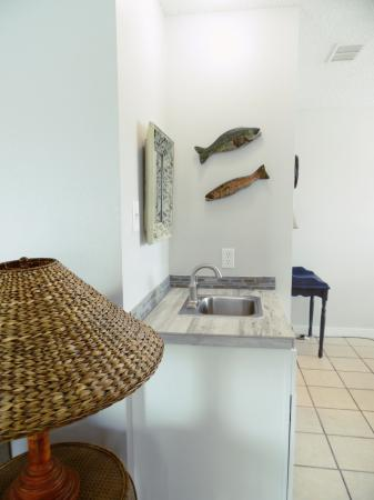 Click to enlarge image Wet bar in the dining area - BeeGee's Tarpon Quarters - One bedroom, with king bed, one bath. LARGE condo with laundry, tile floors, Dog Friendly.Walk to the beach.