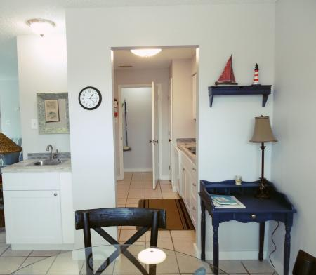 Click to enlarge image From the dining room through the kitchen - BeeGee's Tarpon Quarters - One bedroom, with king bed, one bath. LARGE condo with laundry, tile floors, Dog Friendly.Walk to the beach.