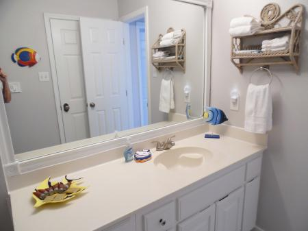 Click to enlarge image Sparkly new bathroom - BeeGee's Tarpon Quarters - One bedroom, with king bed, one bath. LARGE condo with laundry, tile floors, Dog Friendly.Walk to the beach.