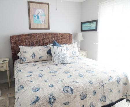 Click to enlarge image Comfy king bed - BeeGee's Tarpon Quarters - One bedroom, with king bed, one bath. LARGE condo with laundry, tile floors, Dog Friendly.Walk to the beach.