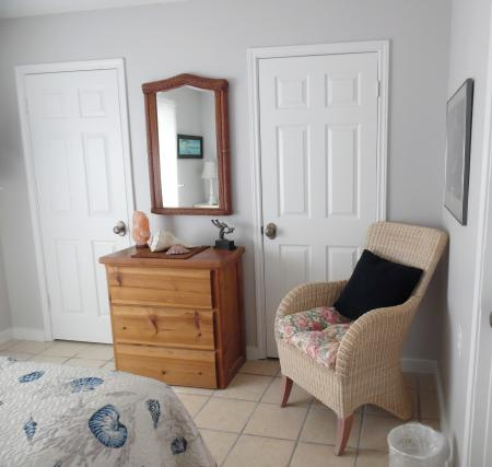 Click to enlarge image Two large closets and tv in bedroom - BeeGee's Tarpon Quarters - One bedroom, with king bed, one bath. LARGE condo with laundry, tile floors, Dog Friendly.Walk to the beach.
