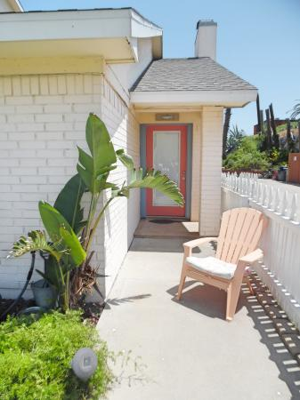 Click to enlarge image Front entrance from the fenced yard - BeeGee's Tarpon Quarters - One bedroom, with king bed, one bath. LARGE condo with laundry, tile floors, Dog Friendly.Walk to the beach.