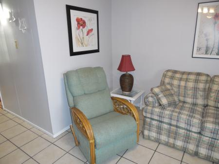 Click to enlarge image Recliner for relaxation - Mustang Isle #28 - One Bedroom Condo, Sleeps two, galley kitchen and queen bedroom.