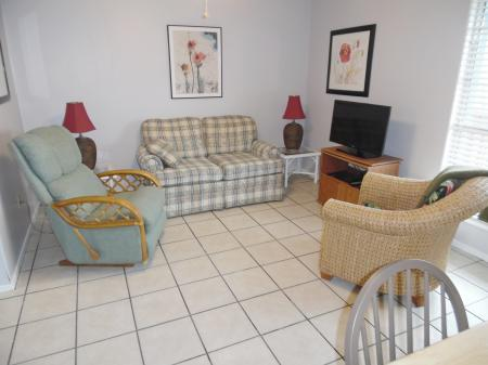 Click to enlarge image Comfy living room - Mustang Isle #28 - One Bedroom Condo, Sleeps two, galley kitchen and queen bedroom.