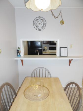 Click to enlarge image Pass through from kitchen to dining - Mustang Isle #28 - One Bedroom Condo, Sleeps two, galley kitchen and queen bedroom.