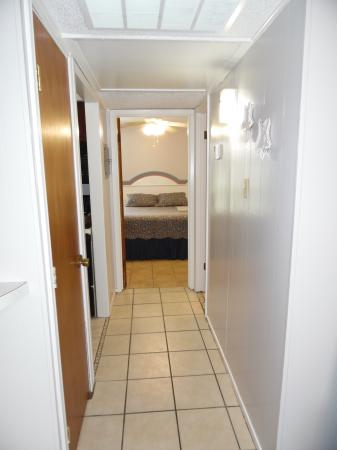 Click to enlarge image Hallway to bedroom and bath - Mustang Isle #28 - One Bedroom Condo, Sleeps two, galley kitchen and queen bedroom.