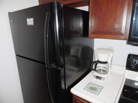 Click to enlarge image Galley kitchen with full sized appliances - Mustang Isle #28 - One Bedroom Condo, Sleeps two, galley kitchen and queen bedroom.