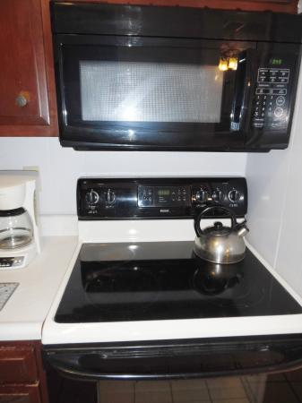 Click to enlarge image Electric stove and microwave - Mustang Isle #28 - One Bedroom Condo, Sleeps two, galley kitchen and queen bedroom.