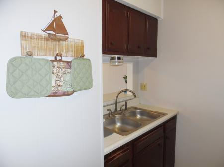 Click to enlarge image Kitchen has everything you need to cook your catch - Mustang Isle #28 - One Bedroom Condo, Sleeps two, galley kitchen and queen bedroom.