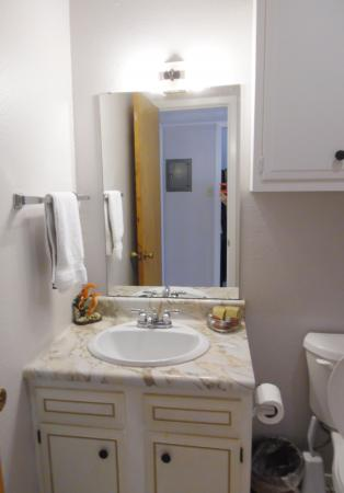 Click to enlarge image Bright bathroom with vanity storage - Mustang Isle #28 - One Bedroom Condo, Sleeps two, galley kitchen and queen bedroom.