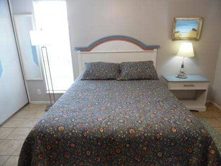 Click to enlarge image Queen bed in the bedroom - Mustang Isle #28 - One Bedroom Condo, Sleeps two, galley kitchen and queen bedroom.