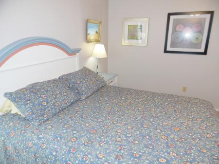 Click to enlarge image Comfy queen bed - Mustang Isle #28 - One Bedroom Condo, Sleeps two, galley kitchen and queen bedroom.