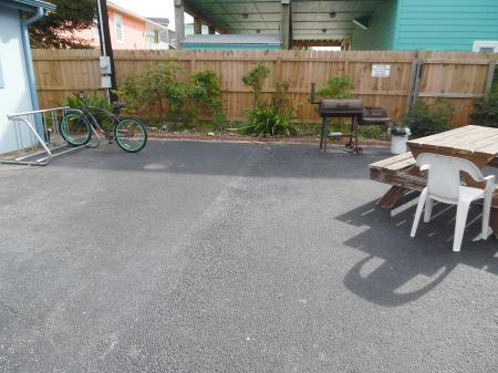 Click to enlarge image Picnic area with a grill for guests to use - Mustang Isle #28 - One Bedroom Condo, Sleeps two, galley kitchen and queen bedroom.