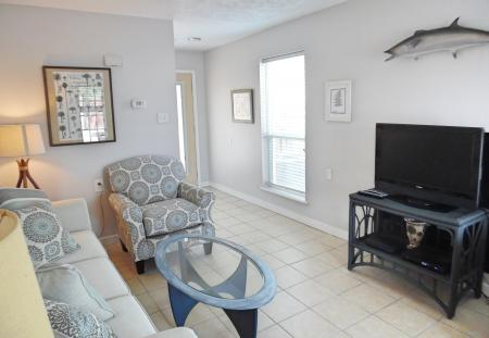 Click to enlarge image Tv and internet throughout the condo - BeeGee's Wahoo Quarters - One bedroom, one bath, LARGE condo with laundry, tile floors, Dog Friendly. Walk to beach