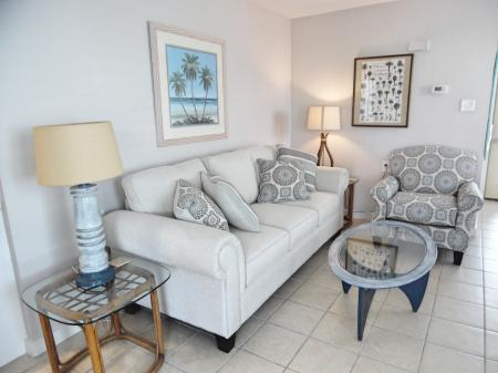 Click to enlarge image Comfy living room with queen sleeper - BeeGee's Wahoo Quarters - One bedroom, one bath, LARGE condo with laundry, tile floors, Dog Friendly. Walk to beach