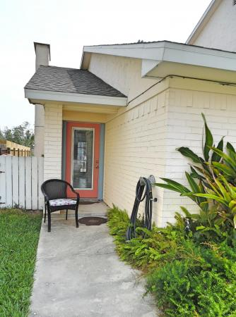 Click to enlarge image Front entrance from the large fenced yard - BeeGee's Wahoo Quarters - One bedroom, one bath, LARGE condo with laundry, tile floors, Dog Friendly. Walk to beach