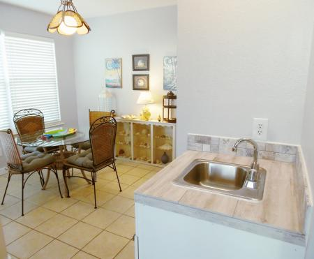 Click to enlarge image Wet bar between living and dining areas - BeeGee's Wahoo Quarters - One bedroom, one bath, LARGE condo with laundry, tile floors, Dog Friendly. Walk to beach