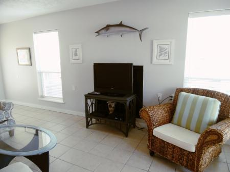 Click to enlarge image Extra seating for guests and a Wahoo on the wall! - BeeGee's Wahoo Quarters - One bedroom, one bath, LARGE condo with laundry, tile floors, Dog Friendly. Walk to beach