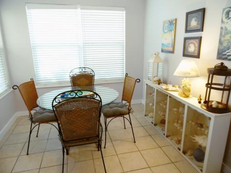 Click to enlarge image Dining room-check out the shell collection - BeeGee's Wahoo Quarters - One bedroom, one bath, LARGE condo with laundry, tile floors, Dog Friendly. Walk to beach