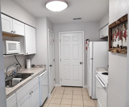 Click to enlarge image Remodeled kitchen and laundry room - BeeGee's Wahoo Quarters - One bedroom, one bath, LARGE condo with laundry, tile floors, Dog Friendly. Walk to beach