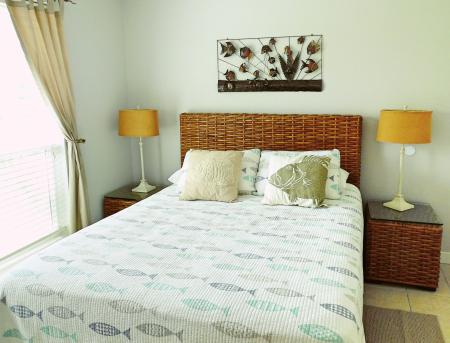 Click to enlarge image Queen bedroom - BeeGee's Wahoo Quarters - One bedroom, one bath, LARGE condo with laundry, tile floors, Dog Friendly. Walk to beach