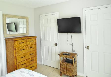 Click to enlarge image Tv and 2 large closets - BeeGee's Wahoo Quarters - One bedroom, one bath, LARGE condo with laundry, tile floors, Dog Friendly. Walk to beach