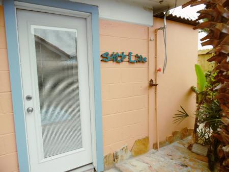 Click to enlarge image Door to back garden has an outdoor shower for people and pets sand removal - La Tortuga, lovely new remodel, Spanish Village #12 - Charming coastal cottage, private fenced yard, dog ok