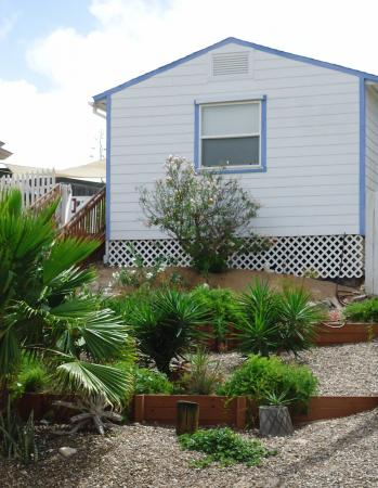 Click to enlarge image Cottage in the Dunes Guesthouse - Cottage in the Dunes - This home is the guest house for the Dome, Can be rented separately. Enjoy the pool. One bedroom, one bath,kichen laundry. Sleeps 2-4.